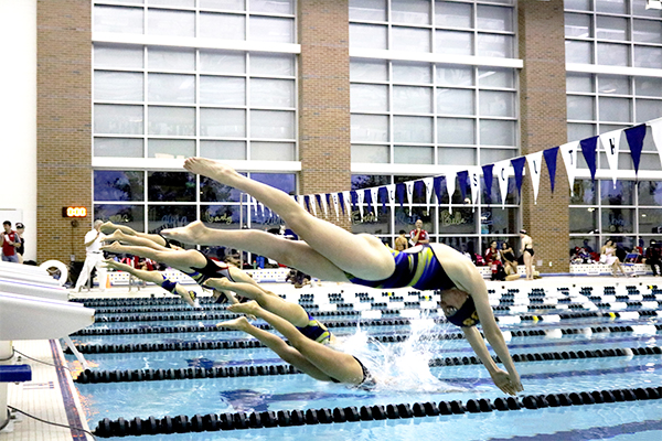 DIVING ME CRAZY:  Beginning her event, junior Leza Bergin competes against Niles West on Oct. 27. The Titans defeated the Wolves 94-92 and celebrated the class of 2018 at their senior night.