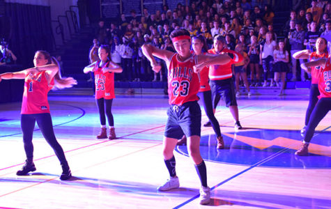 KILLER KIM:  Senior co-captain Eden Kim helps lead the De La Cru team at the Pep Rally. Kim and fellow co-captain Chloe McKerr say they are attempting to develop new styles for the team this year.