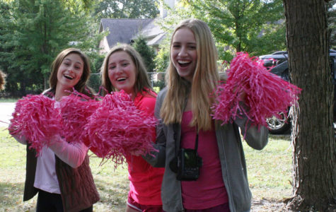 STRIDES FOR A CURE:   Cheering at a Cure Club event (left), sophomores Lina Pedrelli, Sammy Tvaroh and Erin Nukk smile for the camera. Gathering for a group photo (right),  Cure Club members huddle together after their Stride for a Cure event. Last year, Cure Club raised approximately $50,000 for cancer research, a number they hope to surpass this year.