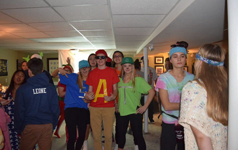 Young Life members pose for a picture at their halloween party.