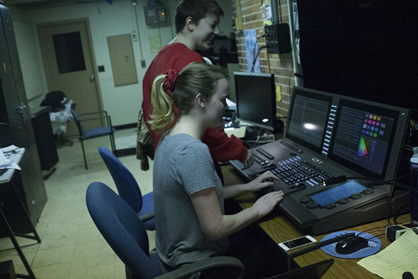 STUPENDOUS STAGE CREW:  Stage Crew members, juniors Emma Isaacs and Dru Tibbetts, work together on the sound board to change the lighting of the stage. Stage Crew creates unique sets for each production they work on.
