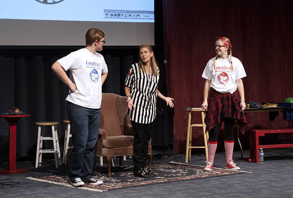 PUNNY PALS:   Performing under the spotlight, juniors Jack Taylor and Ellie Eavenson improvise their act during the Comedy Sportz show, alongside Leader Beth Ann Barber. Two teams compete for points in Comedy Sportz competitions and audience participation is always incorporated.