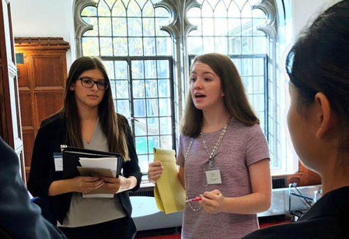 MOTIVATED MCGRATH: Junior Maddy McGrath gives a pep talk to other students at a Model UN conference. McGrath is on the board of Model UN, and is enrolled in AP Government, and AP U.S. History, in hopes of pursuing a career in government in the future.
