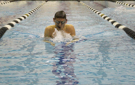 Coming up to take a breath, senior Nick Shectman competed against Highland Park on Feb 3. The meet was the Titan's senior night, where the team honored the graduating senior class.