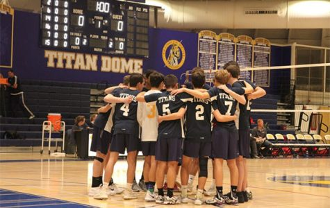DREAM TEAM: Huddling during a game, the Men's volleyball team discusses the next play. The Titans finished 17-15 and 6-4 in conference.