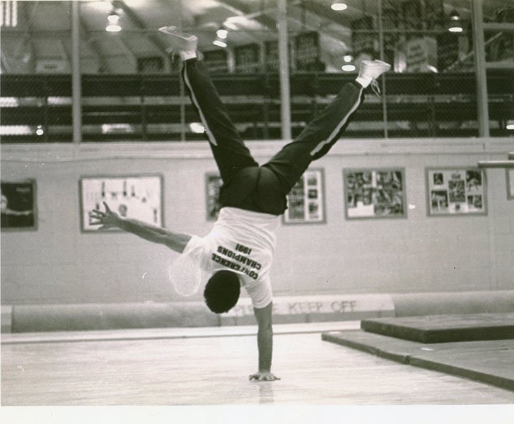 REMEMBERING THE RETIREES: Standing on one hand, Phil Carello demonstrates his experience in gymnastics (above), as he helped coach the men's gymnastics team for 16 years until 2005, and is now retiring after 21 years as a staff member.