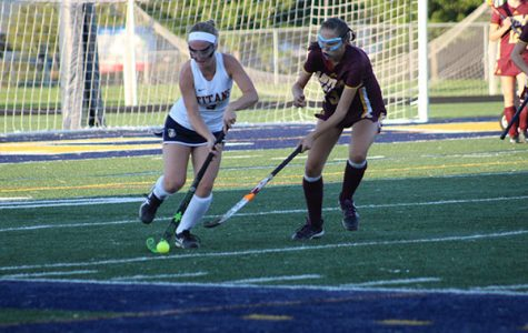 Dribbling up the field, junior Mary Jane McNary focuses on the ball during her game on Sept. 12 against Loyola. Photo by Maricel Lehner