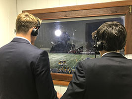 broadcast  partners:   Looking over and observing the Titan's home opener against Palatine, broadcast partners Henry Schleizer and Michael Poulton call the action for listeners. Schleizer's passion for                broadcasting was influenced from a young age by watching Bears football and Chicago sports.  Photo courtesy of Henry Schleizer