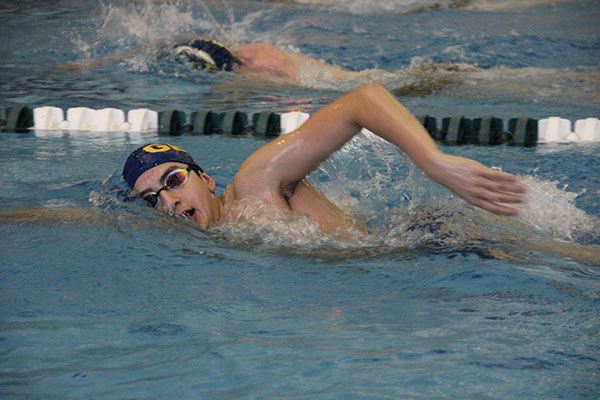 Turning to take a breath, sophomore Sami Moussally competes in the GBS Time Trials on Dec. 1. The Time Trials took place at South where several schools competed.