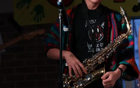 A NIGHT FOR HUMAN RIGHTS: Jamming on the stage, sophomore Yeon Park plays his saxophone at Jamnesty. This event took place on Friday, April 12 in the West Cafeteria and featured different acts as well as information speeches about human rights.