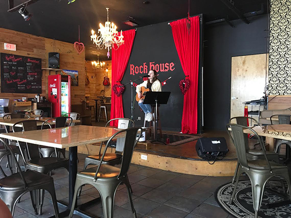 Playing the guitar and singing, junior Emily Patt performs at Rock House before announcing their closure of the cafe and stage in April of 2018. Rock House intends to shut down of the cafe to further develop their music school.