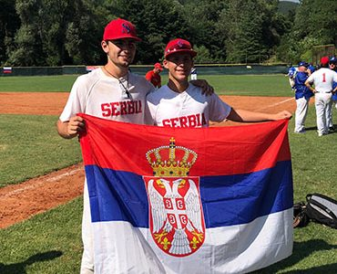 Smiling Sava: Posing with teammates, Sava Dupor (number 6) had a successful run of games in Sofia, Bulgaria over the summer. Dupor was recruited to the Serbian National Team as a pitcher by Coach George Grkinich after playing for the GBS baseball team last spring.