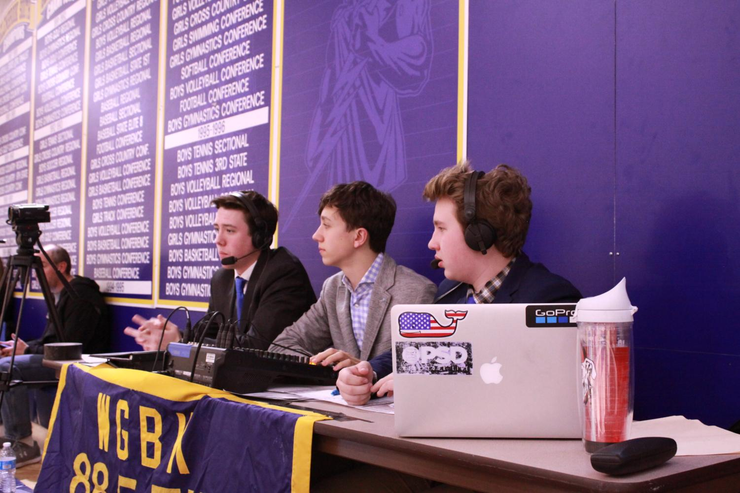 On air action: Bruce Klosa, Jonas Evans and Bryce Gaubert, junior radio commentators, announced the boys' basketball game on Dec. 13. As the game continued, they described the game play-by-play and gave analysis. Photo by Nicole Surcel