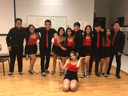 Lively latinos: Getting together for practice, members of Latino Heat walk into a place that feels like a second home to them. They have a special bond with one another, as they have the opportunity to express their ethnicity through dance together.