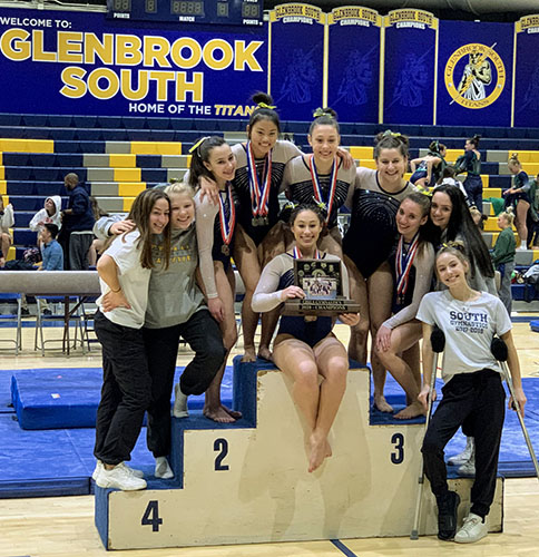 Triumphant gymnasts: Leaping through the air to the left and flipping to the right, junior Elena Pauker, competes on beam at the CSL girls' gymnastics varsity meet. After the conference meet ended, the varsity gymnasts celebrated their victory on the podium, as featured in the center. Photos by Nicole Surcel (left and right) and courtesy of  Bob Szafranski (middle)