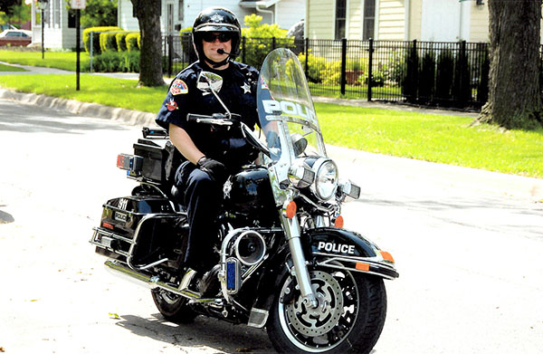 Crusin' Cavender: Riding his motorcycle, Officer Cavender's duties as a motorcycle cop include patrolling public events, like Fourth of July parades. Photo courtesy of Josh Cavender