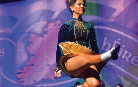 From then to now: Dancing through the years, senior Madaket Chiarieri leaps across the stage at her last competition ever. Chiarieri has Irish danced competitively since she was five years old.