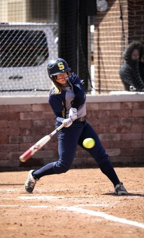 Swinging her bat, senior Maggie Baumstark prepares to score a homerun. Baumstark anticipates the start of a new season following its cancellation this past spring.