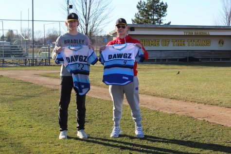 Baseball best friends: Beaming under the March sun, Cole Luckey (left) and George Korompilas (right) hold out their childhood baseball jerseys with their home varsity field behind them.