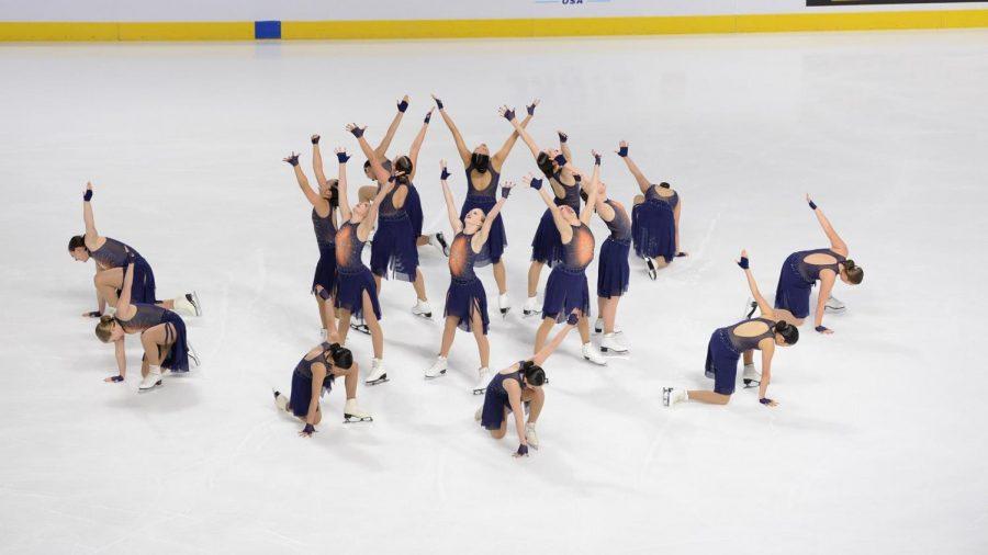 Skating stars: Smiling through their program, Team Elite strikes a pose.