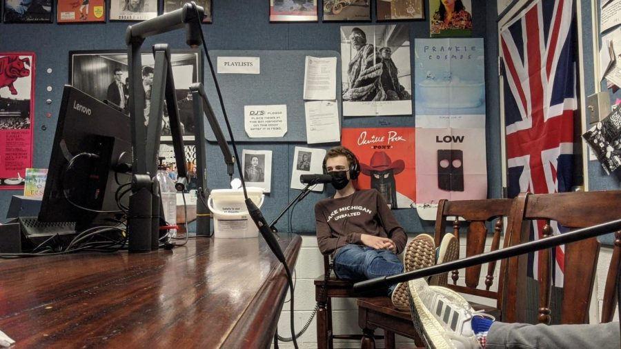 Moments that matter: Recording his sports talk show, Marquardt sits in South's radio studio  hours after school. For Marquardt, South's radio program has been an outlet for him to enjoy all that the school had to offer for him as a student. Photo courtesy of Tommy Marquardt