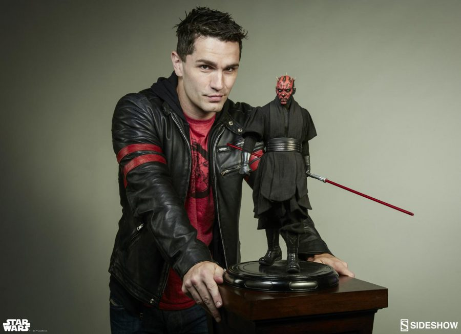 Sith Lord Sam: Posing for the camera, South alumnus Sam Witwer stands next to a figurine of Darth Maul from the Star Wars movie franchise. Witwer voices this character in Star Wars: The Clone Wars. Photo courtesy of Sam Witwer