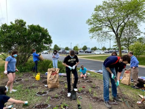 Club Collaboration: Planet Green and Elpida members work together to plant a pollinator garden.