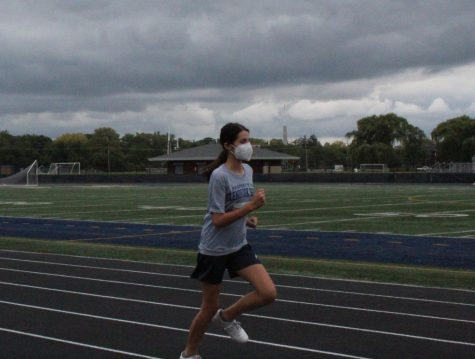 Trouble on the Track: Freshman, Sophia Abraham runs along the track during gym class.